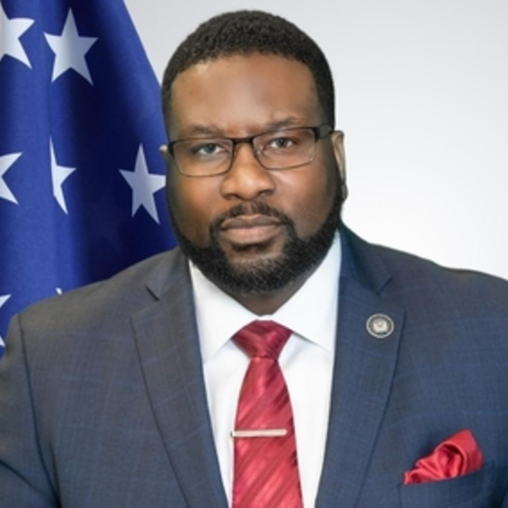 Commissioner Spencer R. Moore Bio